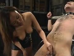 Asian playboy Annie Cruz enjoys torturing Sir C in a basement