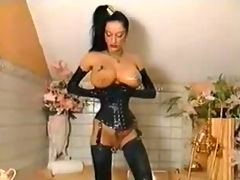 Leather corset makes her waist small