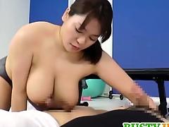Mizuki Ann rubs cocks with successful assets
