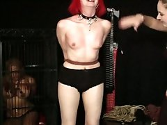 Alt angel is strung up and whipped as another slave watches