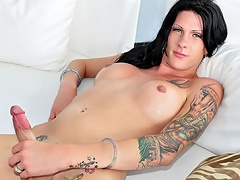 Tattooed ladyboy shows her ass a& cock and she enjoys it!...