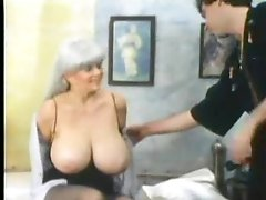 Retro foreplay porn with massive boobs chick
