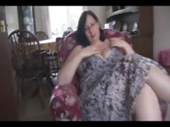 Fat mature jet-black hair with huge tits and ass sticks dildo in her pussy