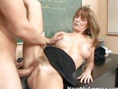 A hard cock gets slammed into mature slut Trisha Lynne's hairy pussy.