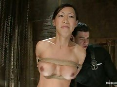 Asian hottie Tia Ling gets her lucious tits and steamy cunt teased while fastened up
