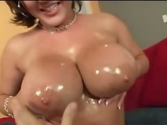 Big titty porn star Claire Dames plays with her giant tits and finger...