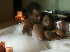 Beautiful ebony with massive boobs does blowjob in bathroom