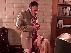 Sluty blonde with huge hooters gives blowjob to nerdy hunk in office