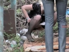 Non-professional cuties in jeans and stockings pissing out of reach of voyeur cam