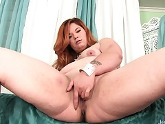 Curvy redhead uses fingers and sex toys to dream her shaved twat to supreme moment
