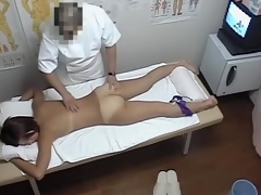 Sex-crazed Oriental female stretches hairy posterior in knead parlor dvd 06