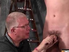 Matured BDSM master gives twink a handjob