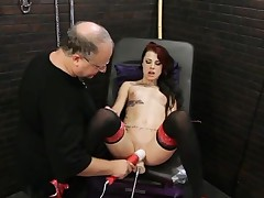 Skinny tattooed girl makes love to a toy machine