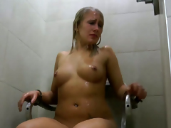 Unrestrained minded dominatrix uses a empty shower as a punishment