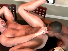White bear cums from dark dick in his ass
