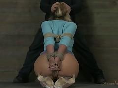Attendant in nylon stockings having her pussy pleasured around trinket in BDSM